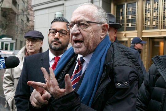 Attorney Alan Dershowitz talks to the press outside federal court, in New York, Monday, Dec. 2, 2019.