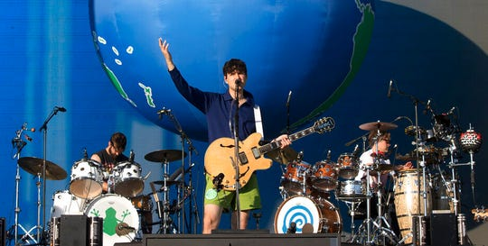 """Ezra Koenig of the band Vampire Weekend performs at the 2019 Firefly Music Festival in this June 23, 2019, file photo. Hipster bands Vampire Weekend and Bon Iver will perform """"caucus concerts"""" on Jan. 31 and Feb. 1."""