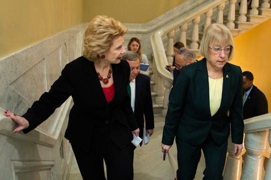 Sen. Debbie Stabenow, D-Mich., left, and Sen. Patty Murray, D-Wash., walk in the U.S. Capitol on the first full day of the impeachment trial of President Donald Trump on charges of abuse of power and obstruction of Congress in Washington, Tuesday, Jan. 21, 2020.