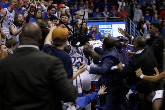 Players brawl during the second half of an NCAA college basketball game between Kansas and Kansas State on Tuesday night.