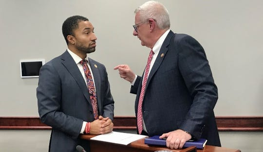 State Sen. Adam Hollier, D-Detroit, left, talks with U.S. Rep. Paul Mitchell, R-Dryen, after a committee hearing in Lansing on Wednesday,  Jan. 22, 2020. Mitchell spoke in opposition to Hollier's bill that would limit local governments' ability to block mining operations.