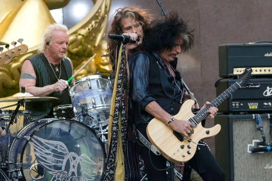 """Joey Kramer, from left, Steven Tyler and Joe Perry of Aerosmith perform on NBC's """"Today"""" show Aug. 15, 2018, at Rockefeller Center in New York."""