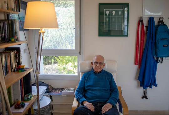 In this Friday, Jan. 17, 2020, photo, Holocaust survivor Maurice Gluck, poses for a photo in his home in Ya'ad, northern Israel.