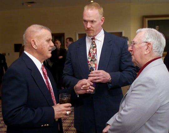 """Former New York Yankees great Bill """"Moose"""" Skowron (left), former Bills tight end Pete Metzelaars (center) and retired Star-Gazette sports editor Al Mallette talk during a media session prior to the 2001 Elmira-Corning All Sports Banquet at Elmira College."""