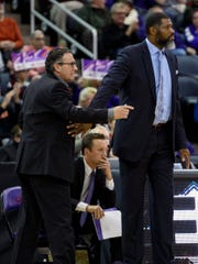 University of Evansville Assistant Coach Todd Lickliter and Head Coach Walter McCarty react to a foul call during the home game against the Ball State University Cardinals at Ford Center in Evansville, Ind., Sunday, Dec. 9, 2018. Lickliter was named the Purple Aces' new head coach after McCarty was fired Tuesday evening, Jan. 21, 2020.