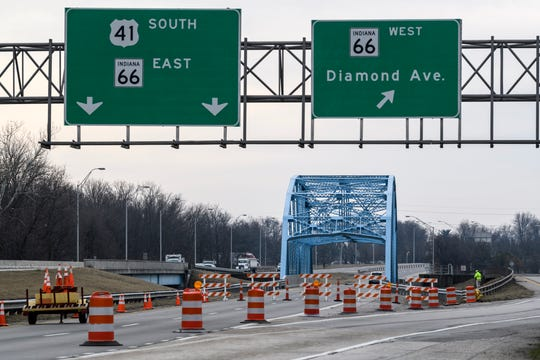 Southbound U.S. 41 traffic is diverted to the Diamond Avenue exit ramp while INDOT workers perform a damage assessment on the Pigeon Creek bridge in Evansville, Wednesday morning, Jan. 22, 2020. A truck hauling an oversized load caused structural damage to the bridge, Tuesday afternoon, causing the bridge to close.