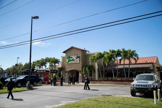 Firefighters monitor the Olive Garden on U.S. 41 in Fort Myers, where smoke was reported in the dining room on Wednesday, Jan. 22, 2020. The building was quickly evacuated, and no one was hurt.