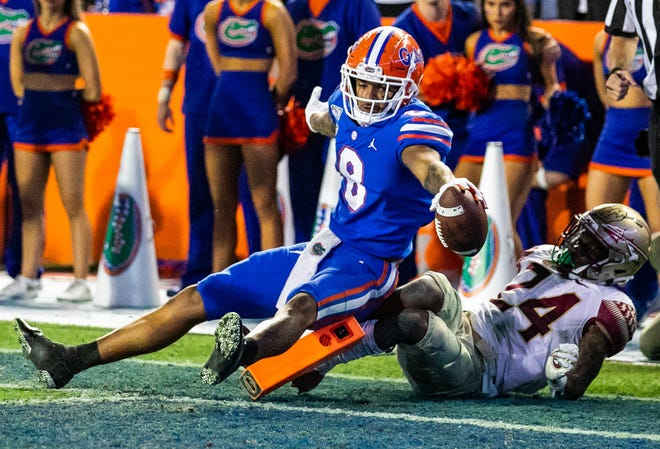 Florida Gators wide receiver Trevon Grimes (8) tries to score a touchdown in the second half while being defended by Florida State Seminoles defensive back Cyrus Fagan (24) during a game Nov. 30, 2019, at Ben Hill Griffin Stadium at Florida Field in Gainesville.