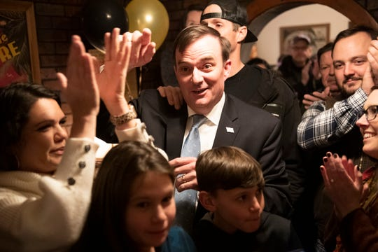 Hobart Lewis celebrates with supporters during a watch party at El Matador Restaurant Tuesday, Jan. 21, 2020.
