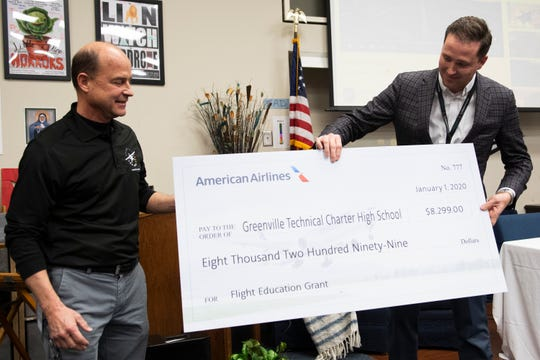Brad Morrison, a manager of pilot recruiting at American Airlines, presents Greenville Technical Charter High School teacher Doug Adomatis with a check for the Flight Education Grant Wednesday, Jan. 22, 2020.