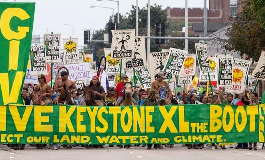 In this Aug. 6, 2017 file photo, demonstrators against the Keystone XL pipeline march in Lincoln, Neb.