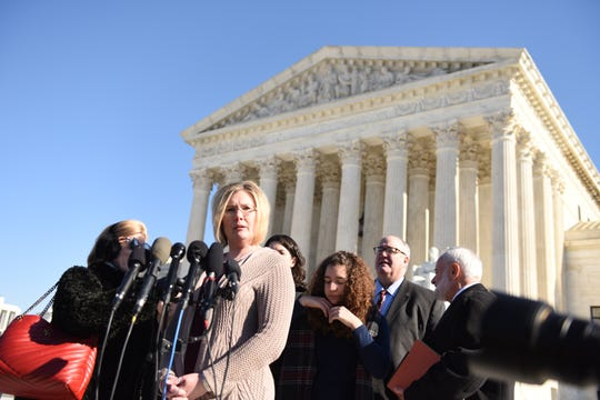 Kendra Espinoza of Montana speaks to the press after the Supreme Court heard arguments in Jan. 22, in Washington.