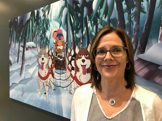 """This June 27, 2019 file photo shows Dorothea Gillim, executive producer and co-creator of """"Molly of Denali,"""" at the Anchorage Museum in Anchorage, Alaska. """"Molly of Denali"""" is the first cartoon series with an Alaska Native character as the lead. It premiered nationwide on PBS Kids in July."""