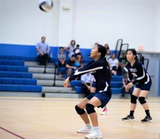Action from a middle school girls volleyball game this past season. The IIAAG recently released its All-Island Team for girls volleyball and boys rugby.