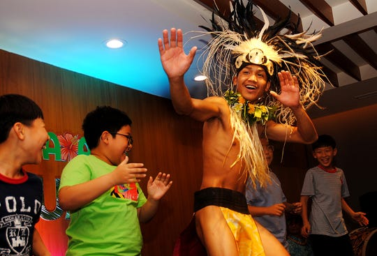 Natibu dancer Clint Augustin wows youngsters during the dinner show at Guam Lotte Hotel in Jan. 17, 2020.