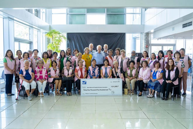 Standing in center back row, the Jones family representatives,from left: Julie Jones Murrell; Jay Jones,senior vice president; Robert H. Jones, chairman and CEO; Jeff Jones, president and COO, with the board and volunteers of the Guam Memorial Hospital Volunteers Association.