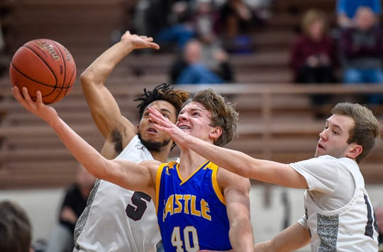 Castle's Caleb Niehaus (40) puts up a shot between defense from Henderson County's Edmund Brooks (5) Holden Raley (14) as the Henderson County Colonels play the Castle Knights at Henderson's Colonel Gym Tuesday evening, January 21, 2020.