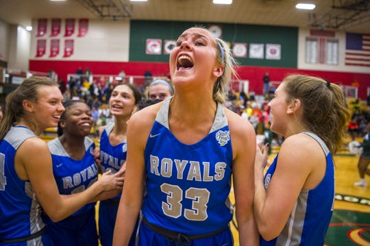 Hamilton Southeastern High School senior Sydney Parrish (33) reacts with her teammates after winning an IHSAA girls  varsity basketball game against Lawrence North High School, Tuesday, Jan. 21, 2020, at Lawrence North High School. Hamilton Southeastern High School won 49-43.
