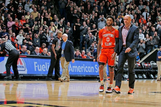 Jan 21, 2020; West Lafayette, Indiana, USA; Illinois Fighting Illini guard Alan Griffin (0) is escorted to the locker room by an assistant coach after being ejected from the game for stepping on the chest of Purdue Boilermakers guard Sasha Stefanovic (55) during the first half at Mackey Arena.