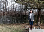 Noblesville homeowner Robin Anderson stands on the Nickel Plate railroad line behind her home in Noblesville, Ind., on Wednesday, Jan. 22, 2020. Anderson is one of many homeowners who qualified for a $2,000 grant to build a new privacy fence near the new trail set to be built behind her home.