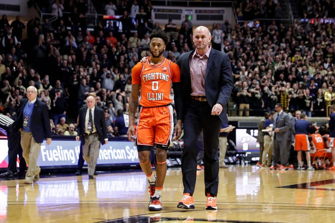 Illinois guard Alan Griffin (0) is escorted off the court after being ejected for a foul during the first half of an NCAA college basketball game against Purdue in West Lafayette, Ind., Tuesday, Jan. 21, 2020.