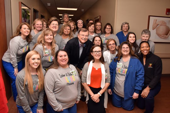 The staff at the new birthing center at North Knoxville Medical Center gathers after the ribbon cutting on Tuesday, Jan. 21. The center will officially open in February. 2020.