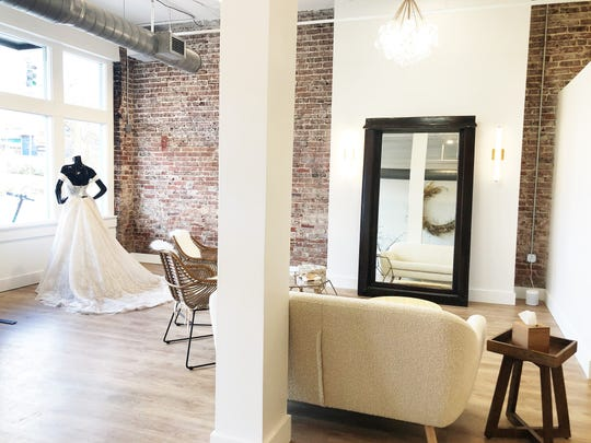 "The retail space at 820 Sevier Ave. is 2,100 square feet and was a blank slate for Anna Wiggins, owner of the Loveliest Bridal Boutique. Original window frames have been repurposed for full-length mirrors and brick walls exposed. ""I just think it's cool that it feels fresh and airy; it's a little more modern but it has elements of the original building,"" said Wiggins."