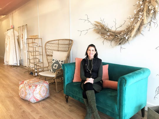 "Loveliest Bridal Boutique owner Anna Wiggins in her new location at 820 Sevier Ave. in South Knoxville on Jan. 21, 2020. Wiggins said the boho décor doubles as an Instagrammable backdrop for brides and their friends. ""I have a master's in city planning and a passion for mixed use. This area is becoming more walkable and mixed use,"" she said."