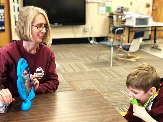 Lizzy Revans, special education teacher, with student Mace Headrick at Dogwood Elementary School on Jan. 22, 2020.