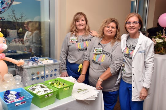 RNs Laura Wilson and Linda Bales greet guests with lactation consultant Cathy Raleigh at the open house for the new birthing center at North Knoxville Medical Center on Tuesday, Jan. 21. 2020