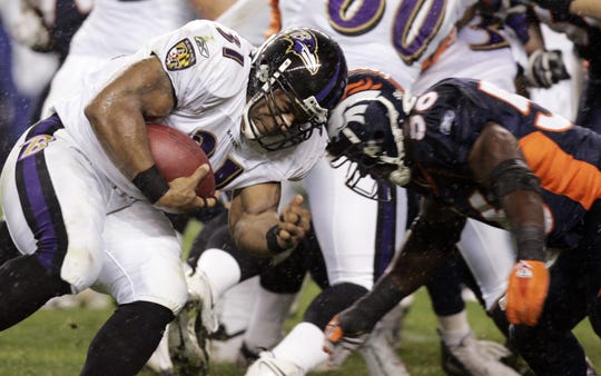 Baltimore Ravens running back Jamal Lewis (31) is hit at the line of scrimmage by Denver Broncos linebacker Al Wilson (56) on Oct. 9, 2006. Lewis is the only ex-Vol to rush for a Super Bowl touchdown, in 2001.