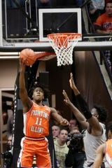 Illinois guard Ayo Dosunmu (11) hooks a shot into the net during the first half of a NCAA men's basketball game, Tuesday, Jan. 21, 2020 at Mackey Arena in West Lafayette.