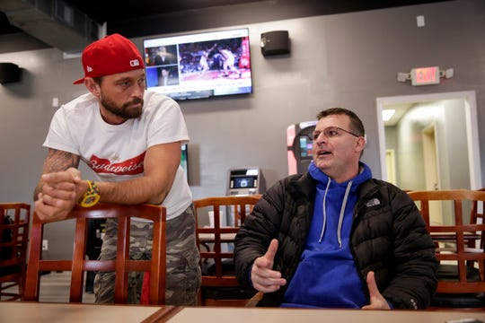 Co-owners, Cory Spurgeon and Jerry Strok talk inside Big League Sports Bar, 140 Frontage road, Wednesday, Jan. 22, 2020 in Lafayette.