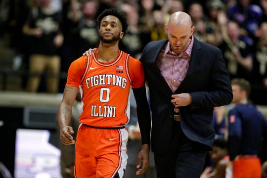 Illinois guard Alan Griffin (0) is escorted off the court after being ejected for a foul during the first half of an NCAA college basketball game against Purdue in West Lafayette, Ind., Tuesday, Jan. 21, 2020. (AP Photo/Michael Conroy)