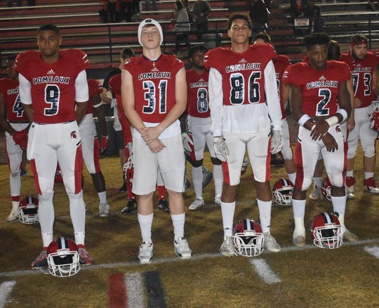 Matthew Carter, the 17-year-old Comeaux High School senior athlete in critical condition after being shot in an armed robbery attempt Saturday, shown here with teammates.