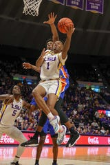 Jan 21, 2020; Baton Rouge, Louisiana, USA;  LSU Tigers guard Javonte Smart (1) drives to the basket against the Florida Gators during the first half at Maravich Assembly Center. Mandatory Credit: Stephen Lew-USA TODAY Sports