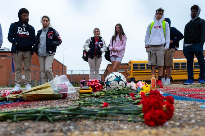 Friends and students at Comeaux High School create memorial in parking lot for 17-year-old Matthew Carter.  Wednesday, Jan. 22, 2020.