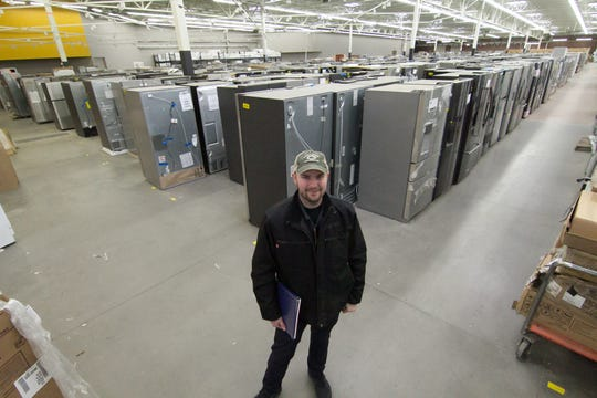 Noble Appliance co-owner Jeremiah Miller stands inside in part of a former Walmart in Hartland Township Wednesday, Jan. 22, 2020. The company is gearing up to open a new store that will also serve as its new headquarters.