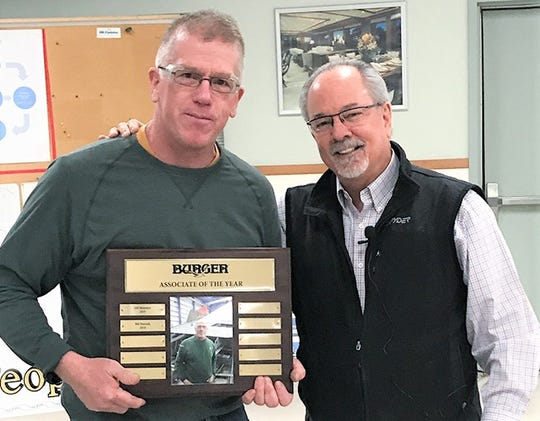 Jeff Hassemer accepts the award for 2019's top associate from Burger Boat Company President and CEO Jim Ruffolo.