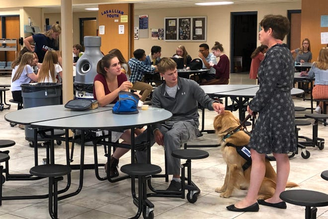 Roncalli students interact with Benson during lunch.