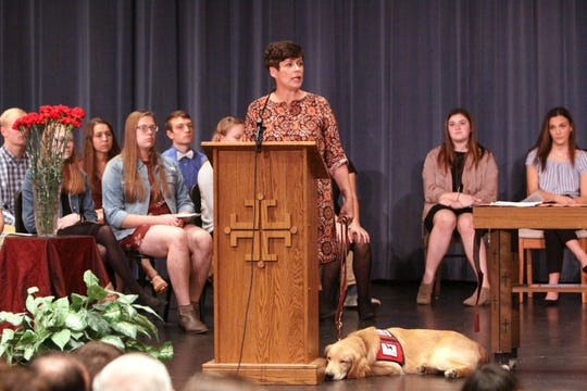 A Roncalli assembly welcomes their service dog.