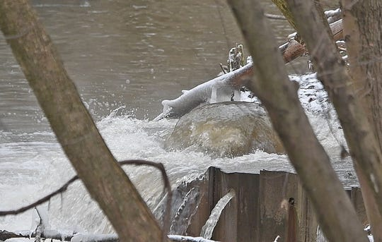 Waste water spilled into the Rocky Fork River near the intersection of Orange Street and Newman Street on Tuesday morning. A backup at the waste water treatment lift station on Park Avenue East caused a manhole cover near the Rocky Fork to dislodge allowing discharge into the river.