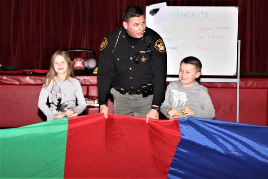 Deputy Mike Woods, center, from the Marion County Sheriff's Office is the new school resource officer at Ridgedale Local Schools. He started his job when the new semester began earlier in January. Woods is an alumnus of Ridgedale. He said he's enjoying working with faculty, staff, and students at his alma mater.
