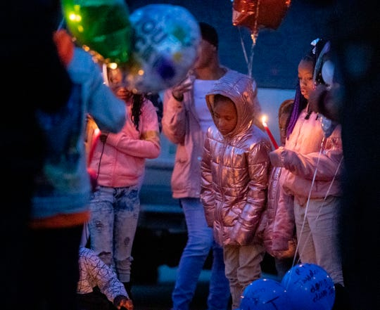 Community members hold candles Tuesday, Jan. 21, 2020, during a vigil for Jadon Knox on the 700 block of Pendleton Street in Memphis. Knox was killed nearby over the weekend.