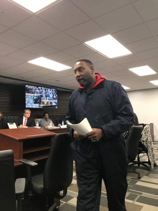 """Memphis sanitation worker Maurice Spivey leaves the Memphis City Council committee room on Tuesday,  Jan. 21. He accused his boss, Solid Waste Director Al Lamar, of operating under """"fraudulent pretenses."""""""