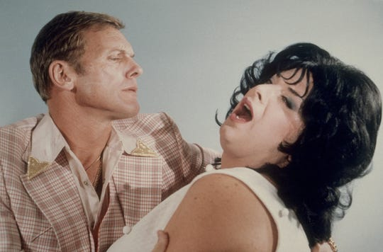 """Tab Hunter and Divine make beautiful music and noxious odors together in John Waters' """"Polyester,"""" which screens Feb. 6 at Crosstown Theater."""