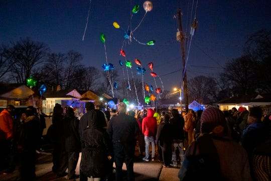 Community members release ballons Tuesday, Jan. 21, 2020, during a vigil for Jadon Knox on the 700 block of Pendleton Street in Memphis. Knox was killed nearby over the weekend.
