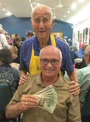JCMI Bingo winner Dr. Herb Kern with Gary Dzendzel.