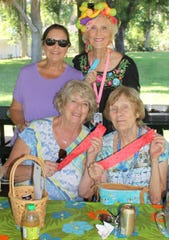 Selling 50/50 tickets are, from left, seated: Cindy MacQuarrie and MaryAnn Cassidy; standing: Donna Reiley and Susie Walsh