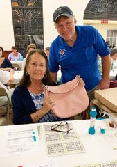 On Jan. 16 the Knights of Columbus San Marco Council #6344 hosted a Bingo night in the San Marco Parish Center. The Coach bag winner is Carol Batterton of Maryland.